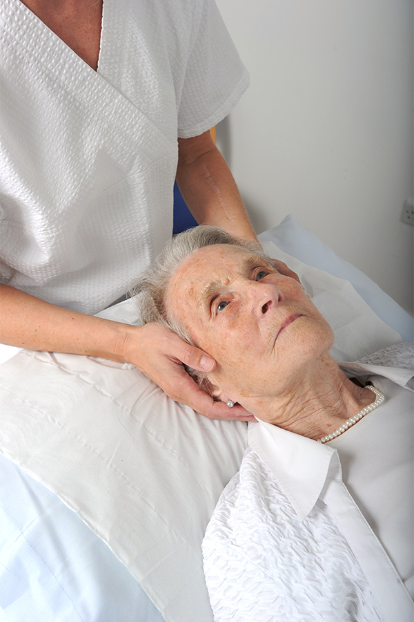 Osteopath treating patient